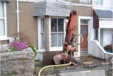 Drilling investigation under a house, from the front garden