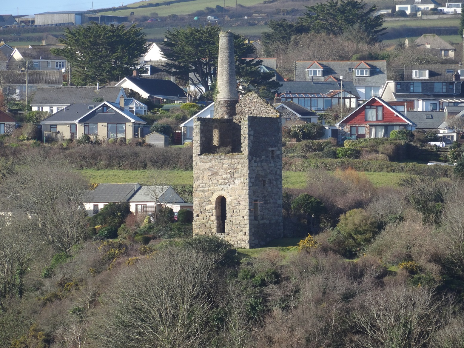 Mine engine house surrounded by houses