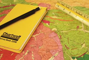 map with writing pad and ruler